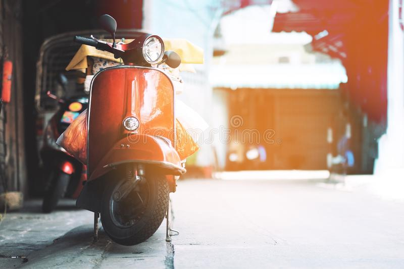 Vintage Red motorcycle in the old city royalty free illustration