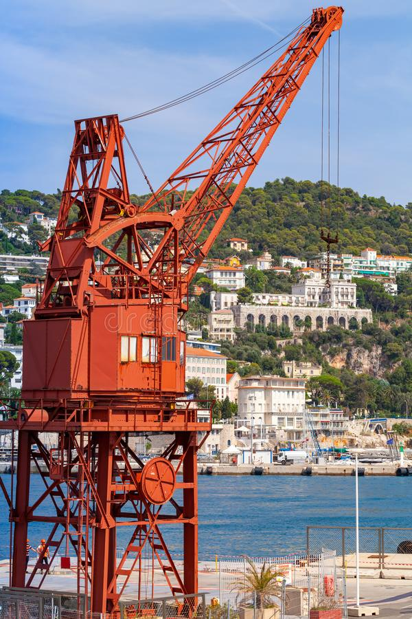 Vintage red port crane. French Riviera, Nice. France royalty free stock photos
