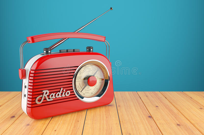 Vintage red radio receiver on wood table. royalty free illustration