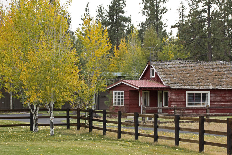 Vintage Red Ranch House In Autumn Stock Photos