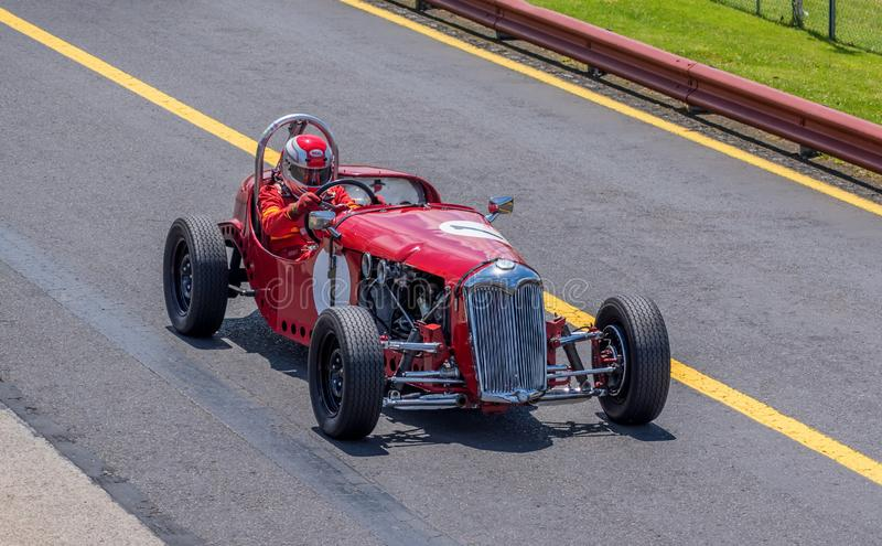 Vintage red Riley racing car stock photography