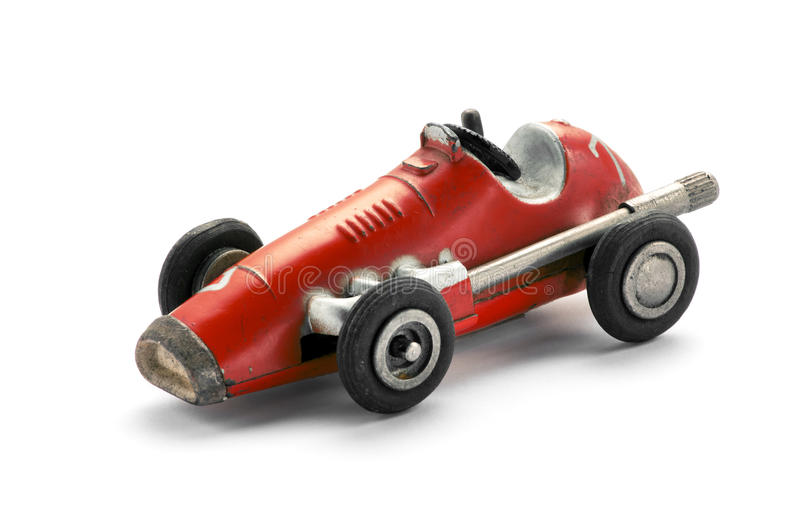 Vintage red toy racing car. Side view on white background royalty free stock images