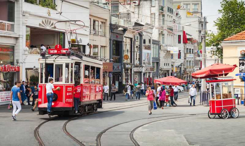 Vintage red tram goes on Istiklal street in Istanbul stock photos