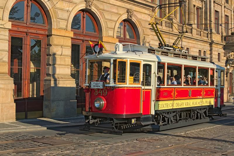 Vintage Red Tram At Street In Historical City Center As Symbol Of