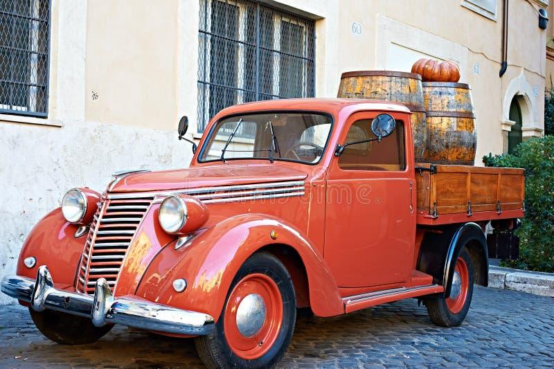Vintage red van with old wooden barrels of wine stock photos