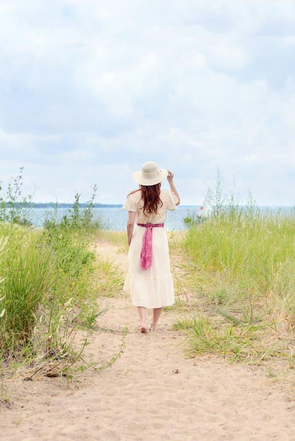 Free Vintage Redhead Woman Walking On Beach Path Stock Photo - 99154100