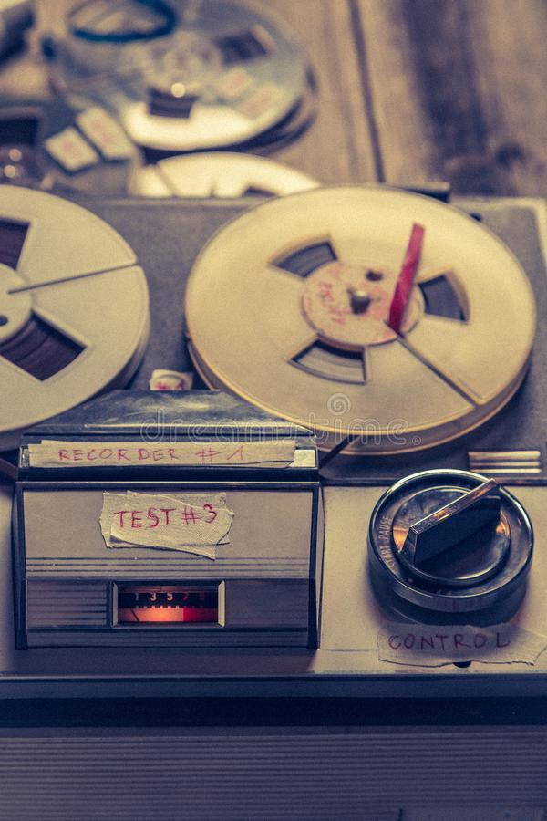 Vintage reel audio recorder with microphone and roll of tape stock photo