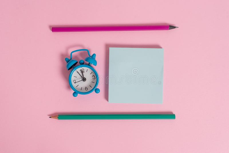 Vintage retro alarm clock wakeup square notepad markers colored background Empty text important events what to do home stock photography