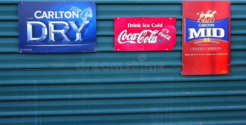 Vintage retro billboards Coca Cola Carlton beer royalty free stock photography