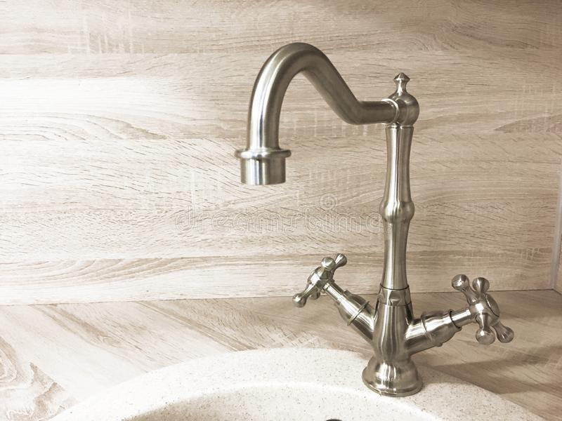 Vintage retro brass water tap faucet closeup on light background royalty free stock image