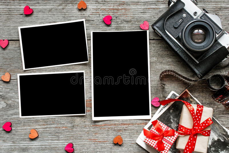 Vintage retro camera on wood table background with blanks photos royalty free stock photos