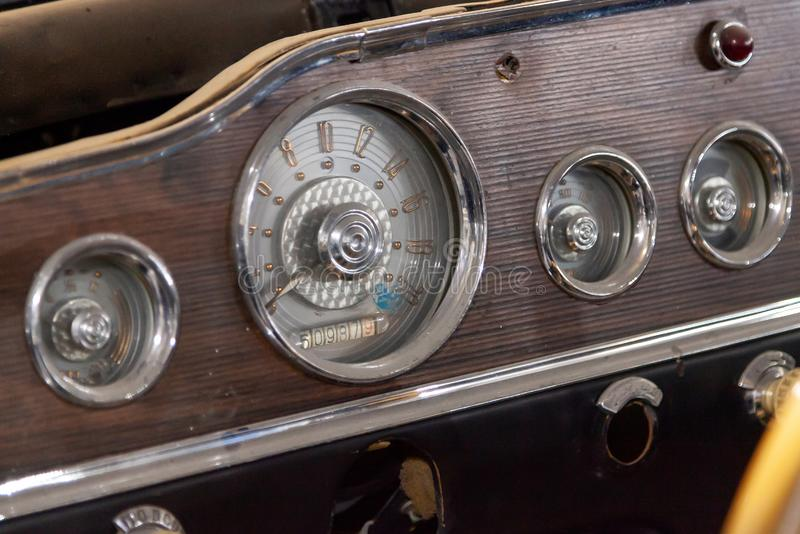 Vintage retro car dashboard with analog speedometer, tachometer and odometer, handmade with wood and chrome stock photos