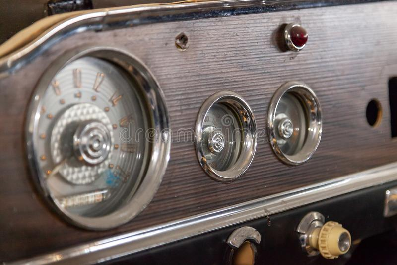 Vintage retro car dashboard with analog speedometer, tachometer and odometer, handmade with wood and chrome for stock image