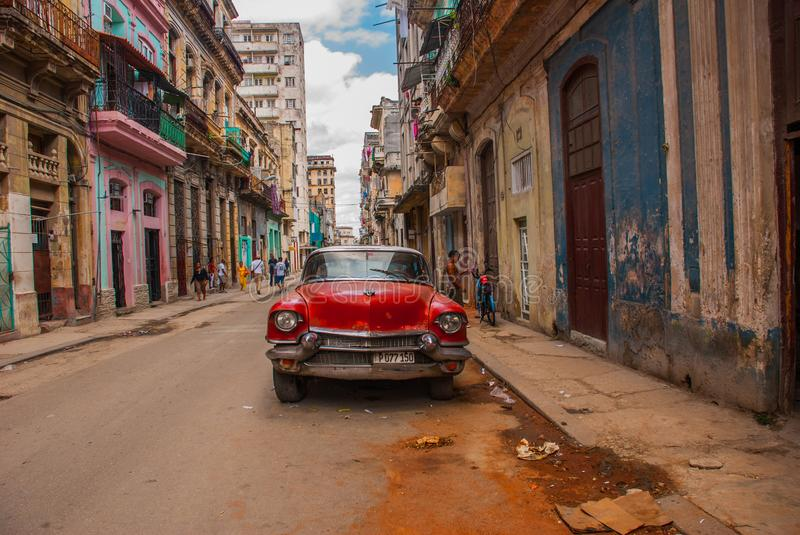 Vintage retro car red on a traditional street in the Old Havana area. Cuba royalty free stock photography
