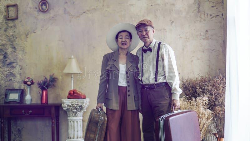 Vintage retro fashion Asian senior couple travel luxury trip aft stock images
