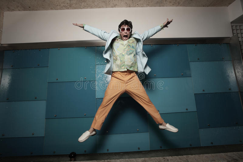 Vintage retro male jumping stock images