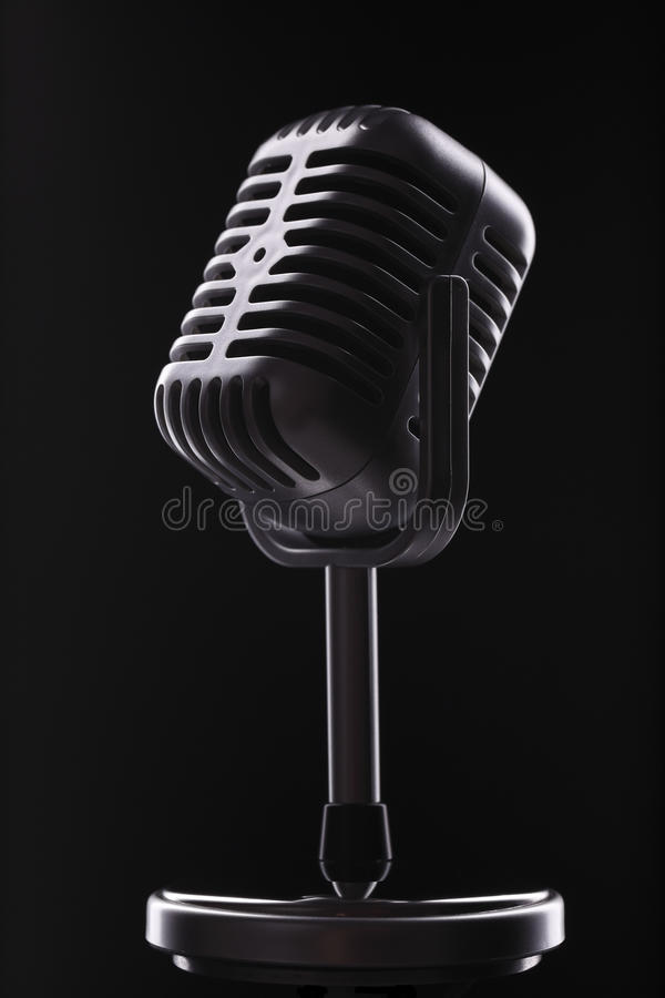 Vintage microphone. Vintage retro microphone close up on the black royalty free stock images