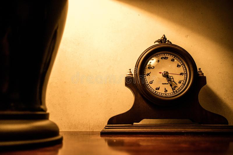 Vintage retro old style wooden clock with Thai number.  stock images