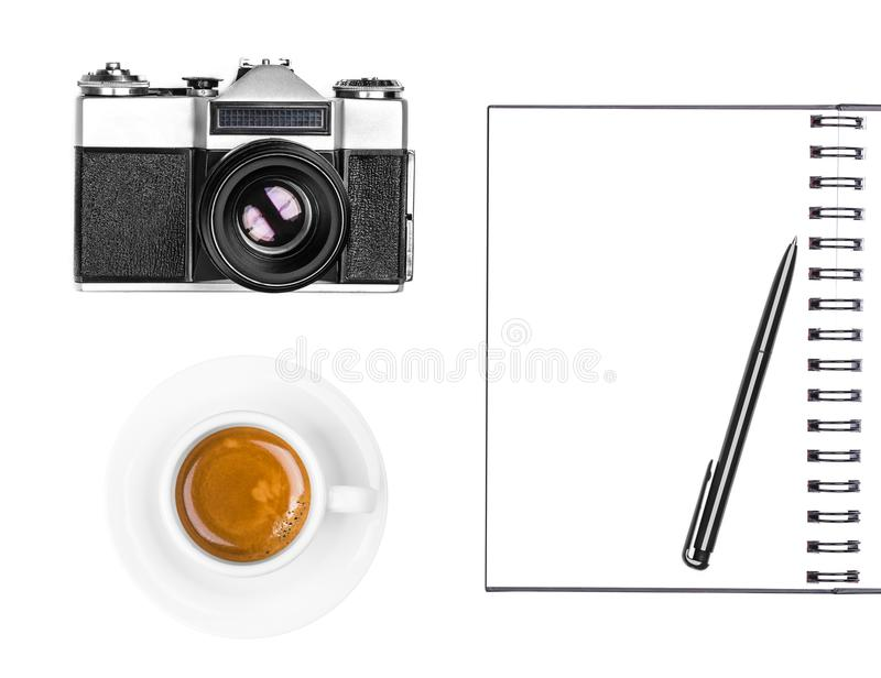 Vintage retro photo camera, coffee cup, notepad and pen isolated on white background. Flat lay, top view stock photos