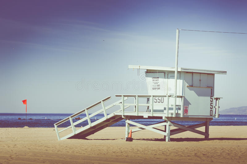 Vintage retro picture of wooden lifeguard tower, Beach in Califo royalty free stock photo