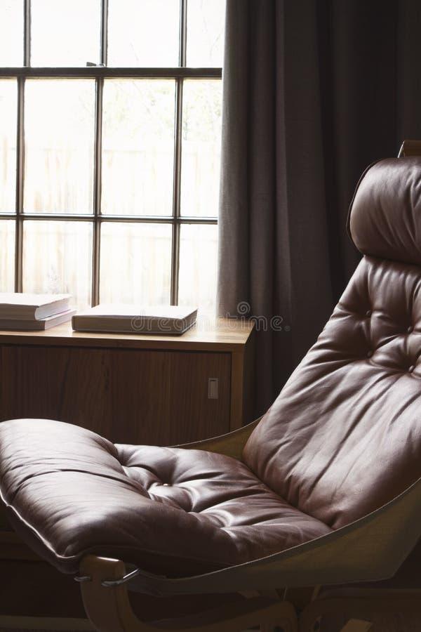 Vintage retro 70s danish tan leather chair. Vintage retro 70s danish tan leather hammock chair stock image