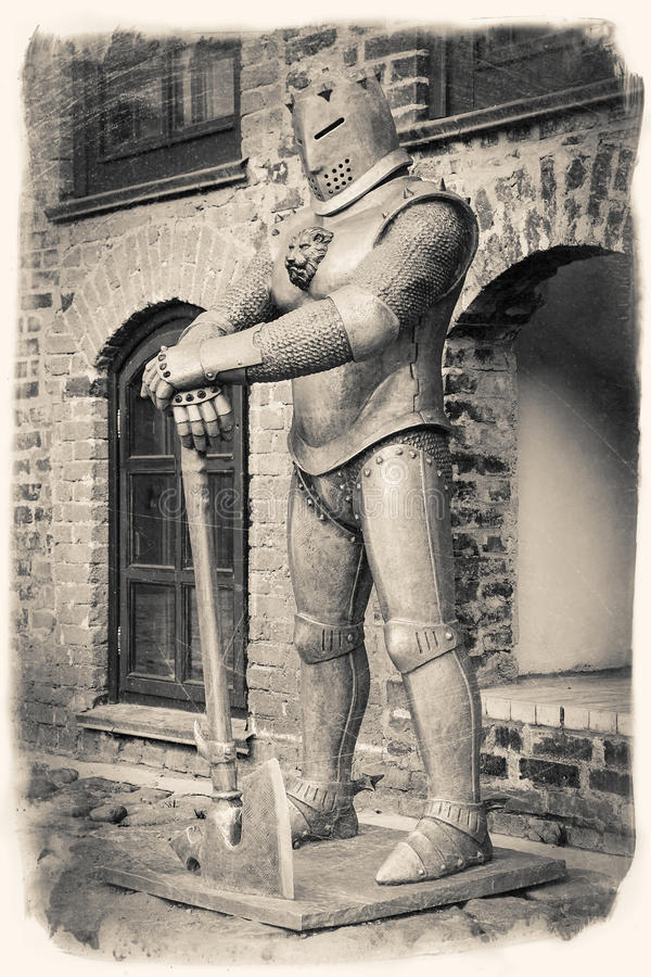 Vintage retro stylized image of medieval knight with axe stock photography