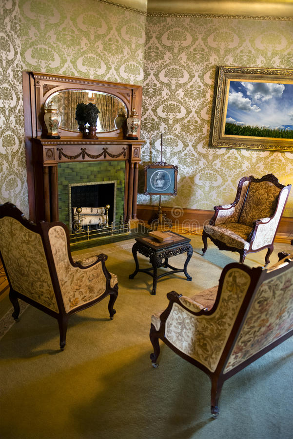 Vintage Retro Victorian Mansion Parlor abd Fireplace royalty free stock images