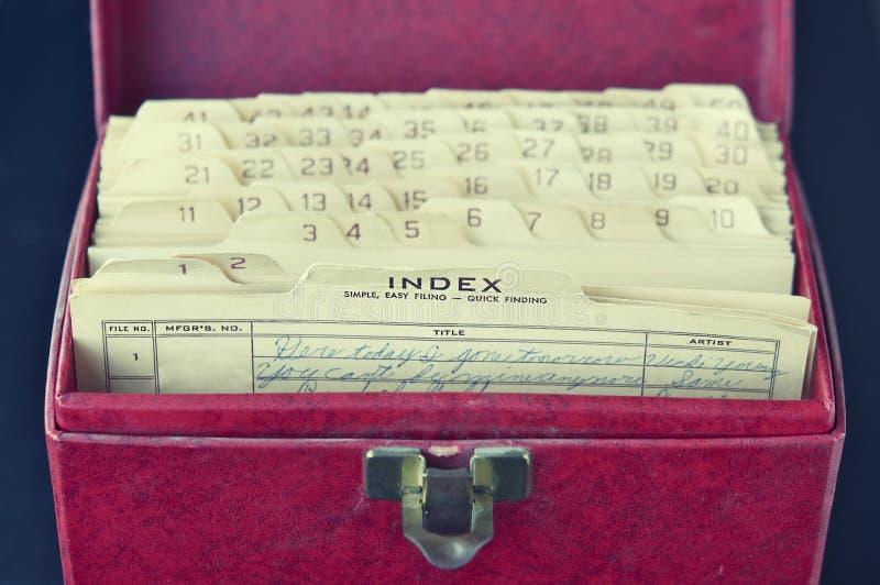 Vintage retro vinyl storage box & index cards. With aged cursive writing stock photo