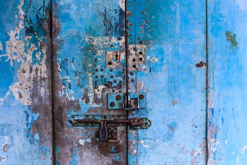 Vintage retro wooden door and slide lock. Home interior architectural design, plain tropical blue painted texture wood panel board stock photo