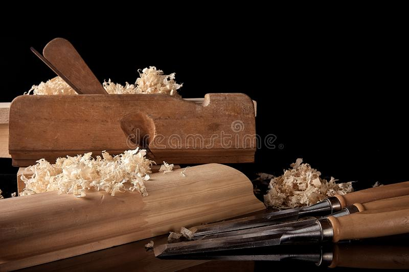 Vintage and the right set of carpenter`s tools on the dark background closeup royalty free stock photos