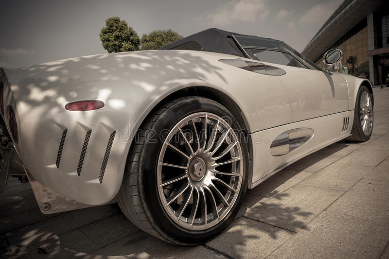 Vintage roadster. Back view of the vintage roadster(The Spyker Car old-style stock photography