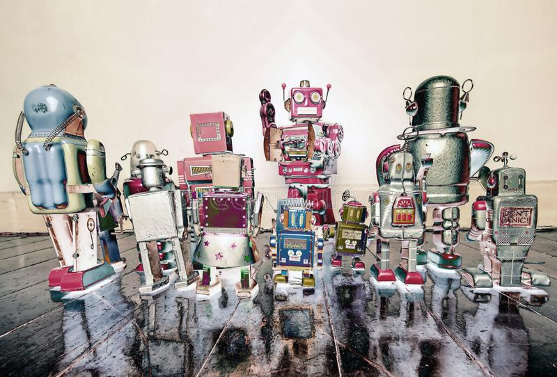 Vintage robot toys having a meeting with the boss solarized royalty free stock photography