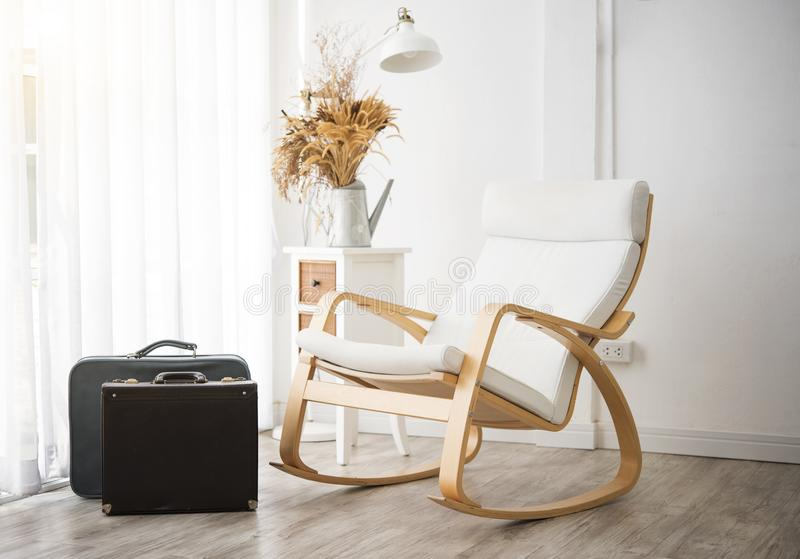 Vintage rocking chair and bag decoration in living room stock photos