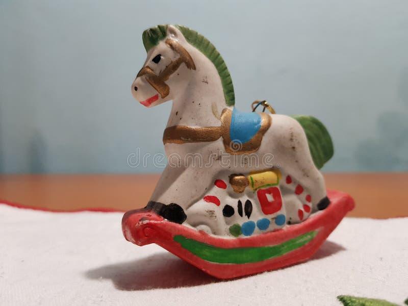 Vintage rocking horse miniature for Christmas tree stock image