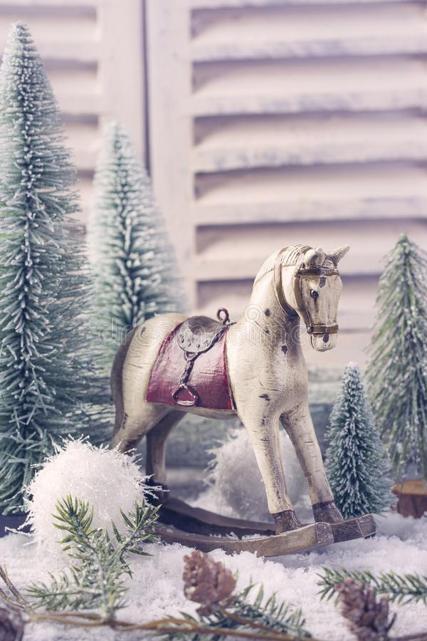 Vintage rocking horse. And small christmas trees royalty free stock image