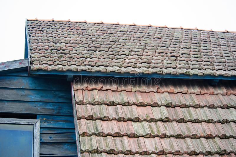 Vintage roof with red tile. Old, detail, pattern, texture, background, house, design, construction, structure, material, architecture, roofing, exterior, row stock images
