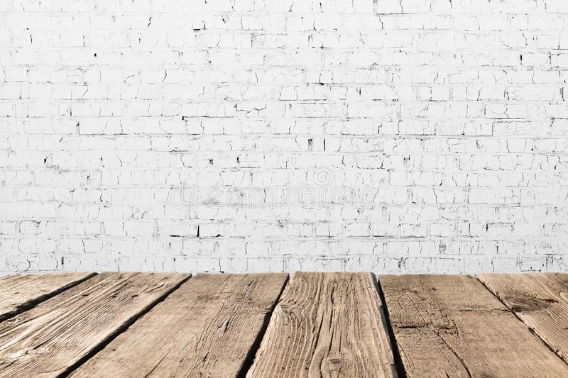 Vintage room interior. Old white brick wall and wooden floor background texture. Space for your background placement or products. stock photos