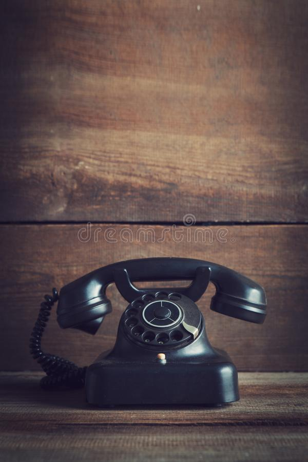 Rotary dial telephone. Vintage rotary dial telephone on wooden board with copy space royalty free stock photography