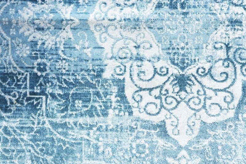 Vintage rug blue eastern texture stock photo