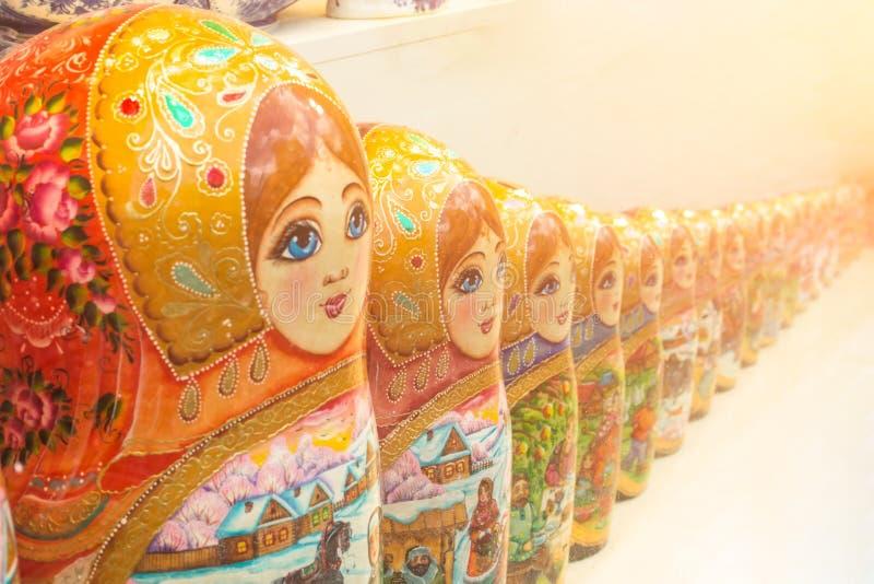 Vintage Russian matryoshka nesting dolls row lined on table. royalty free stock photography