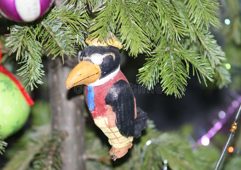 Bird in jacket, antique christmas paper decoration royalty free stock image
