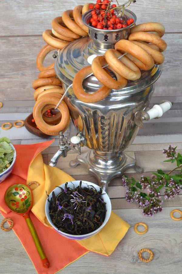Vintage russian samovar, dry herbal tea with bublik royalty free stock image
