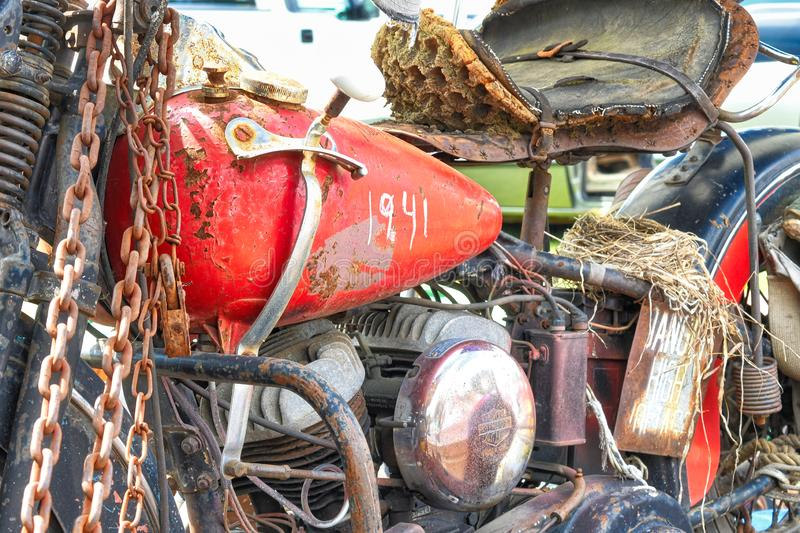 A Rusty Vintage Harley Davidson Motorcycle Sits Alone and Rusted stock photography