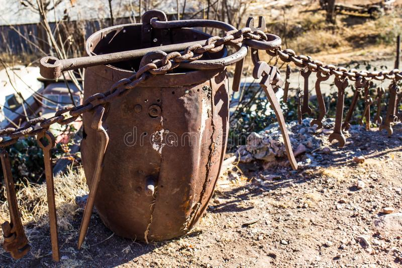 Vintage Rusted Ore Bucket Used In Mining Operations. Vintage Rusted Ore Bucket & Collection Of Wrenches Used In Mining Operations stock photos