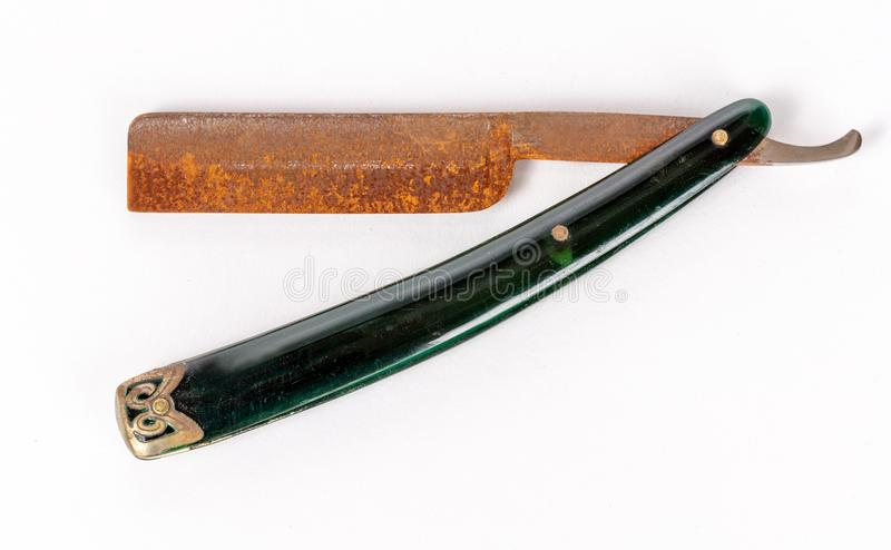 Vintage rusty old straight razor isolated on white background. Vintage Old, rusted, straight razor isolated on white background royalty free stock images