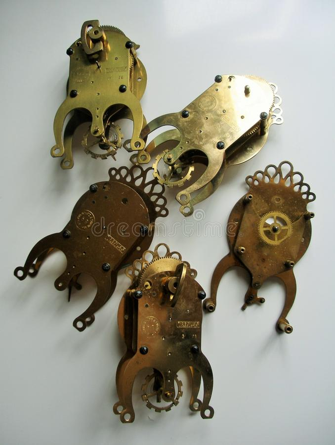 Vintage 1950s 8 day brass clock movements for parts. For steampunk art designs and craft stock photos