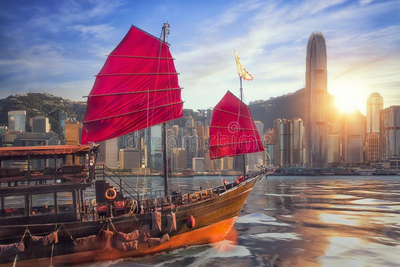 Vintage sail boat fron victoria port to Hongkong harbour. For survice to tourist in Hong kong coty with sunset and blue sky, China, Travel asia and cityscape stock image