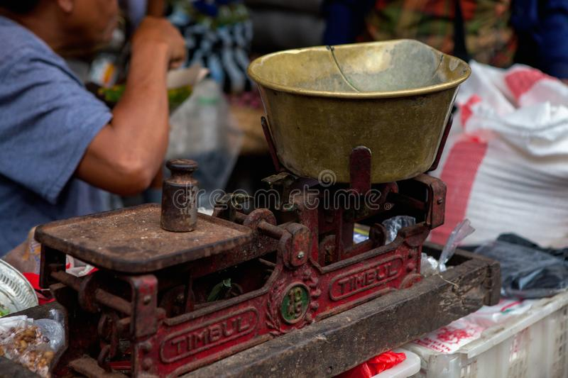 Vintage scales in a local market in Bali stock photo