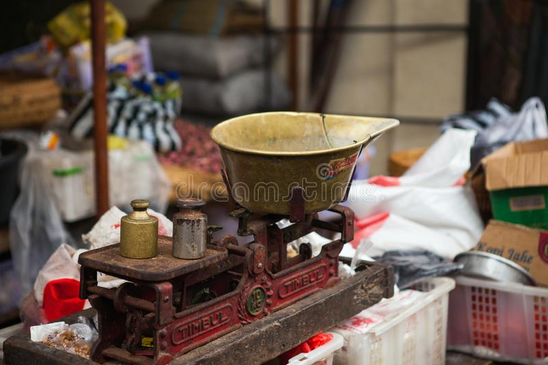 Vintage scales in a local market in Bali royalty free stock image