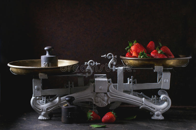 Vintage scales with strawberries stock images